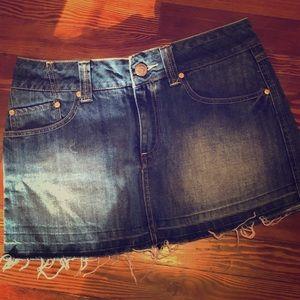 Denim mini skirt with distressed bottom